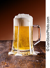 Beer on wooden table - photo of traditional german beer...