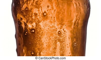 Beer overflowing its glass in slowmotion filmed at 1000fps