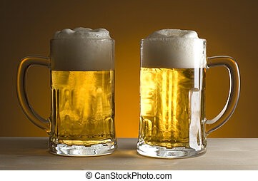 beer - two gasses of beer on orange background close up