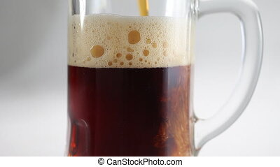 Beer pour in glass beer mug closeup