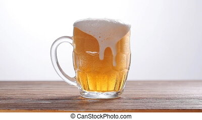 Beer poured into glass on white background