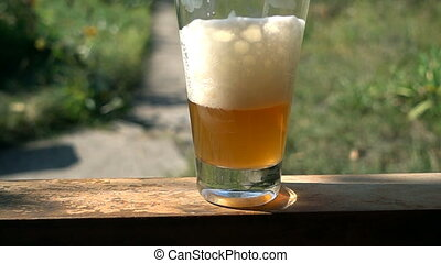 Beer poured into glass. slow motion