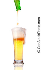 beer pouring from bottle in to the glass with hand isolated