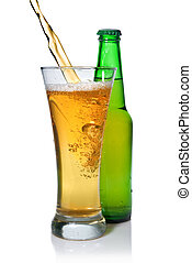 Beer pouring from into glass isolated with bottle on white