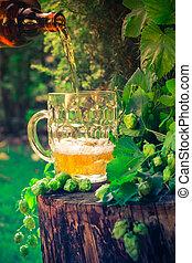 Beer pouring tankard bottle