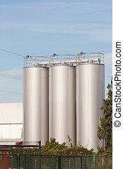 beer processing and storage silos against blue sky