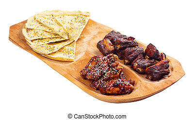 beer snack on the wooden plate