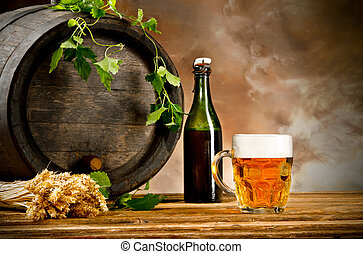 Beer still life - Beer keg with glass of beer and blur ...