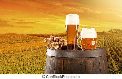 Beer still life - Beer keg with glasses of beer on rural...