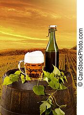 Beer still life - Beer keg with glass of beer on rural...