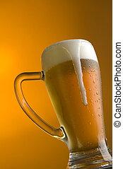 beer - glass of beer on orange background close up