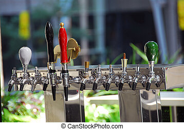 Cold sweating beer tap in outdoor bar