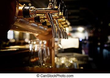 Beer tap - golden shiny beer taps in beer bar