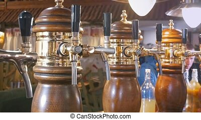 Beer taps at the bar in the restaurant - dolly shot