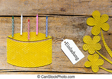 beeswax, cake with candles and flowers on wooden table,...