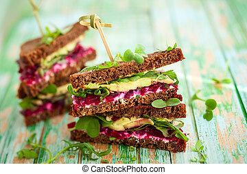 beet, avocado and arugula sandwich - sandwich with beet, ...