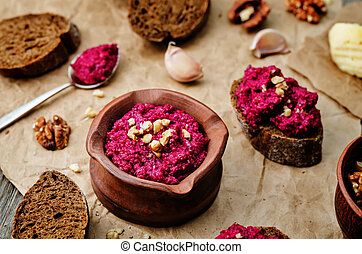 beet pesto on a dark wood background. the toning. selective...