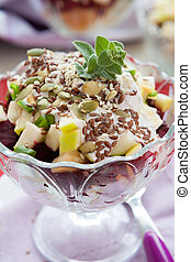 beet salad with apples in a glass bowl