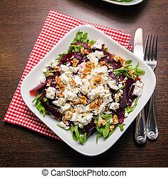 beet salad with arugula, feta cheese and walnut