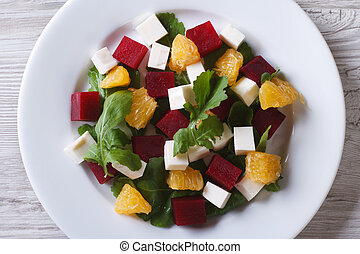 beet salad with cheese and arugula. Horizontal top view closeup