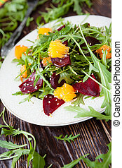 beet salad with fresh arugula and orange