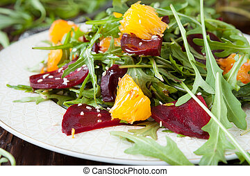beet salad with fresh arugula and slices of orange