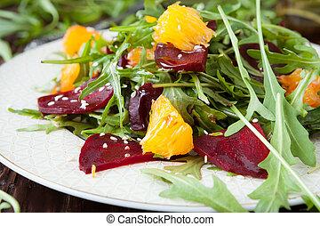 beet salad with fresh arugula and slices of orange