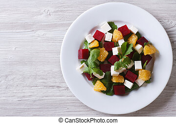 beet salad with oranges, cheese and arugula. Horizontal top view