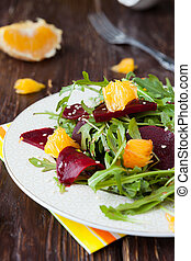 beet salad with slices of orange
