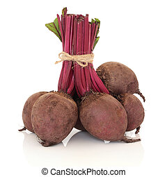Beetroot tied with string, isolated over white background...