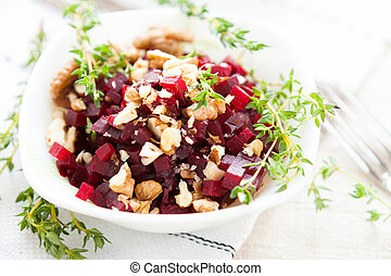 Beetroot salad and nuts, healthy food, close up