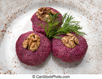 beetroot salad with walnuts on a plate
