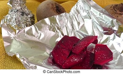 Beetroot wrapped in foil, ready for baking