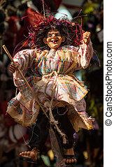 Befana puppet during epiphany celebration in Italy