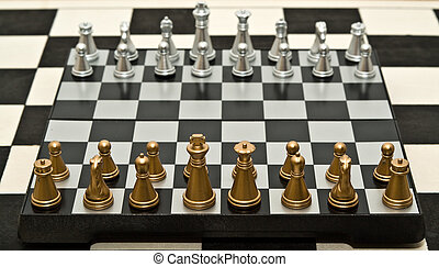 before a game - gold and silver chess on a white background