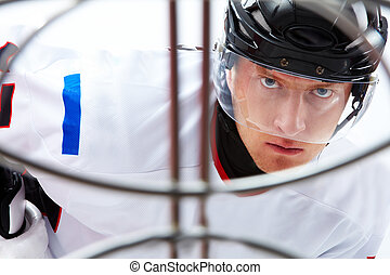 Before goal - Portrait of hockey player looking at adversary...