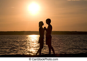 Before kiss - Profiles of romantic couple looking at each ...