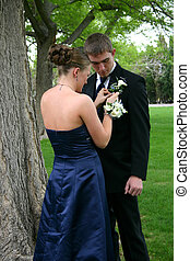 Before Prom - Beautiful young woman concentrates intently as...
