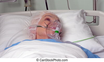 Before surgery - Close-up of an elderly woman with an oxygen...
