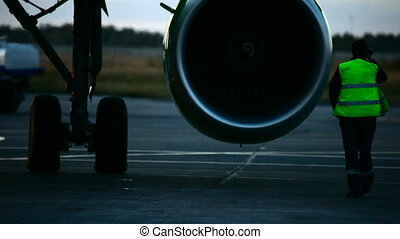 Before the flight. - Towing aircraft on taxiway. Tolmachevo...