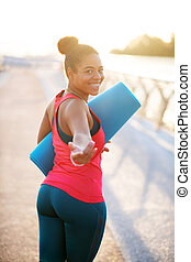 Plump woman working on weight loss walking to yoga