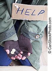 Beggar hands asking for a help