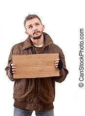 Beggar holding carton suitable for adding text, isolated on...
