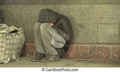 Beggar homeless man tramp. Poverty. Vagrancy. Kyiv. Ukraine...