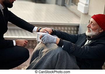 Beggar man sit on walking street and need help
