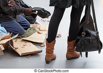Beggar on a crowded street - Beggar sitting on a crowded...