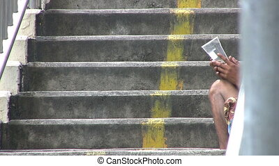 Beggar On A Staircase - A shot of a beggar on a staircase...