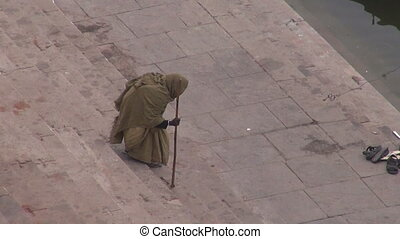 beggar on sacred Ganges river ghats