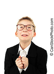 begging boy - schoolboy in glasses begging pardon isolated...