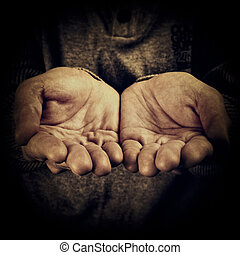 Begging - High contrast image of a person begging